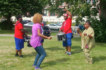 Resident Thelma Sais (right) dances with the Neu-Life Drum Corps. (Photo by Allison Dikanovic)