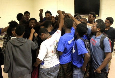 Participants in Youth Works Milwaukee support one another. (Photo by Matthew Wisla)