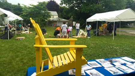 Volunteers painted Adirondack chairs yellow.