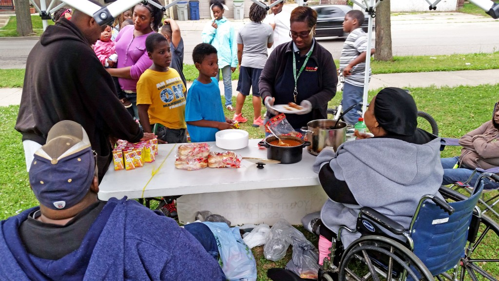 Arthur Ward (front left), his wife Brenda (front right) and their small team of volunteers have been serving free meals at Butterfly Park, 3717 W. Meinecke Ave., for more than 10 years. (Photo by Edgar Mendez)