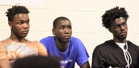 Brothers Christian (left) and Anthony (right) Robinson listen to presentations during a recent Mentor Monday meeting. (Photo by Matthew Wisla)