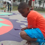 Intersection mural aims to slow traffic, beautify community