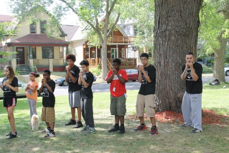 Members of Ace Boxing Club perform a basic skills demonstration at a community event. (Photo by Madeline Kennedy)