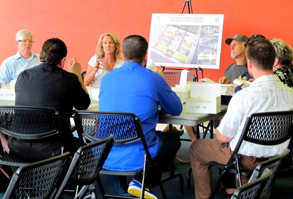 Consultants from HGA Architects and Engineers lead a community workshop to present details about the library design and give participants a chance to ask questions and provide feedback. (Photo by Marlita A. Bevenue)
