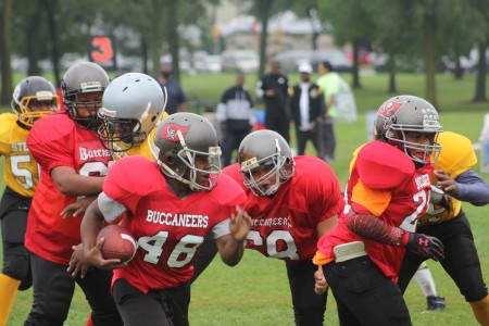 Teamwork and football fundamentals are essential lessons for players in the 57-year-old Neighborhood Children's Sports League. (Photo by Mark Doremus)