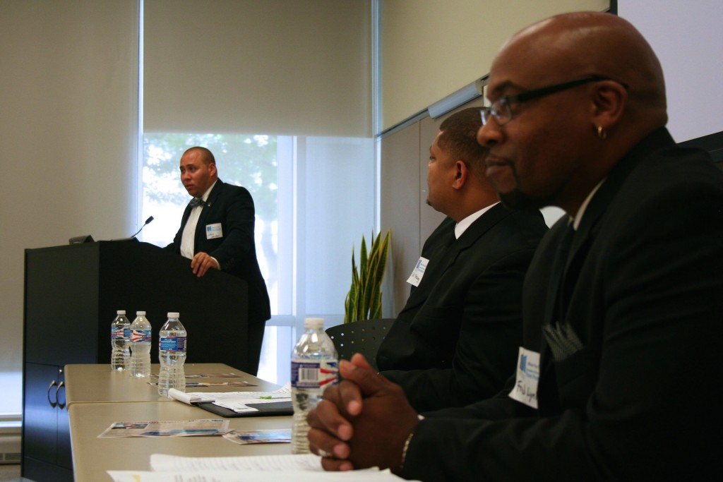 Joshua Johnson (left) addresses attendees at a conference intended to encourage employers to hire ex-convicts. (Photo by Jabril Faraj)