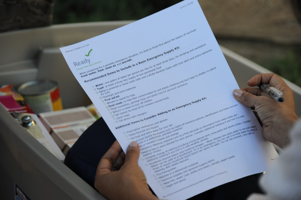 A person fills out an emergency kit checklist. (Photo courtesy of FEMA/Zachary Kittrie)