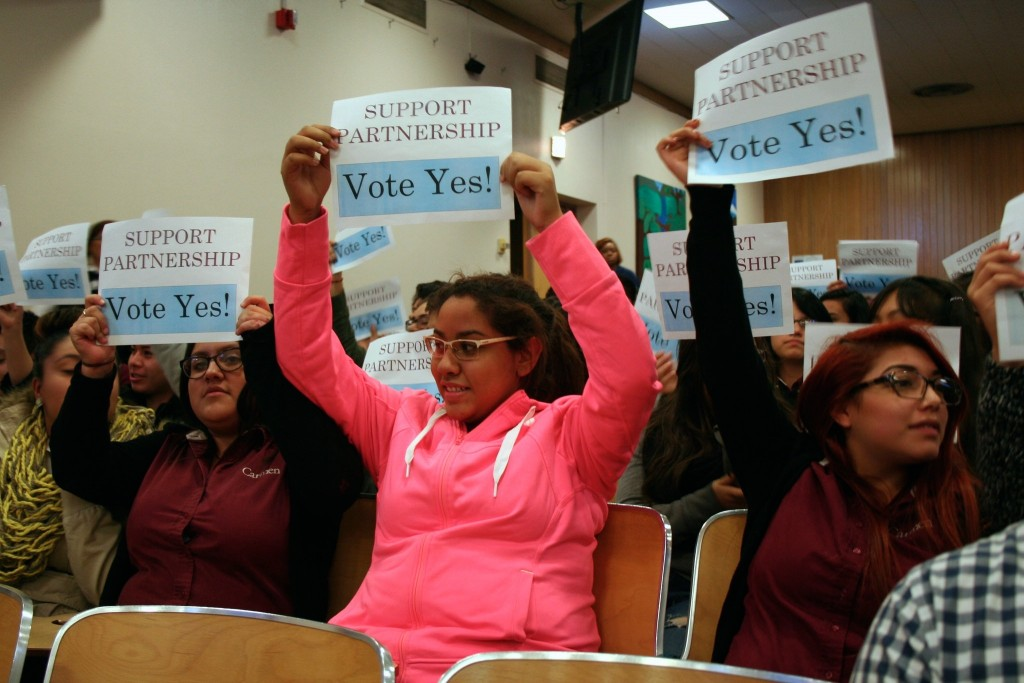 Carmen South students display signs during the October board meeting. (Photo by Jabril Faraj)