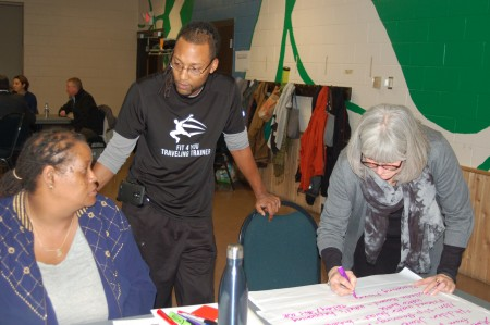 Community members Clara Fleming (left) and Robert Brox contribute their renovation ideas as Quorum architect Allyson Nemec takes notes. (Photo by Andrea Waxman)