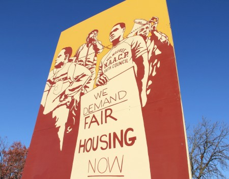 A mural depicting 1960s civil rights activists demonstrating for fair housing in Milwaukee stands at the entry to the Martin Luther King Jr. Peace Place. (Photo by Karen Slattery)