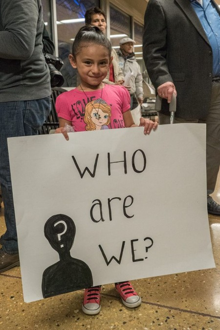 A small girl holds a sign during a rally for supporters of the municipal ID held recently at the Mitchell Park Domes. (Photo by Joe Brusky; courtesy of Milwaukee Teachers' Education Association)