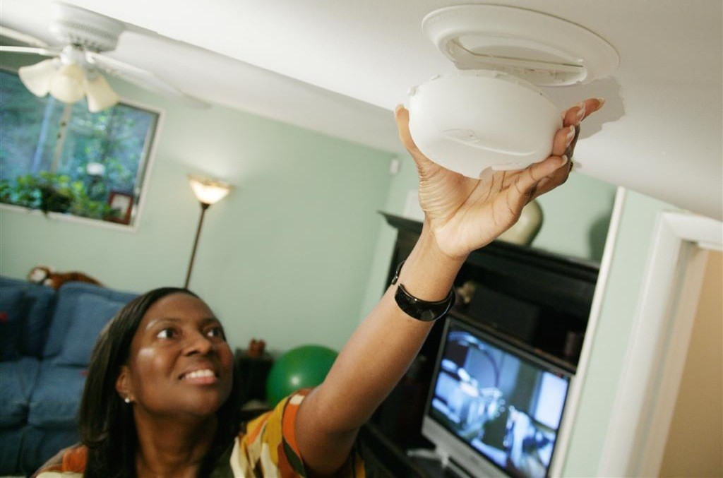 Testing your smoke detector each month takes just a moment, and could save your life. (Photo courtesy of FEMA)