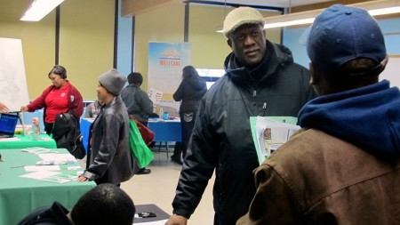 Charles Muhammad attended the housing fair to learn about city programs that can help him improve the empty lot adjacent to his home. (Photo by Wyatt Massey)