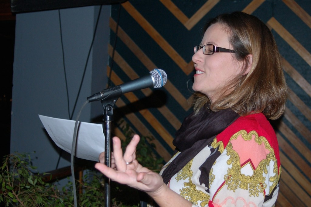 Laura Bray speaks last week at an event to announce finalists for the Milwaukee Awards for Neighborhood Development Innovation (MANDIs). (Photo by Andrea Waxman)