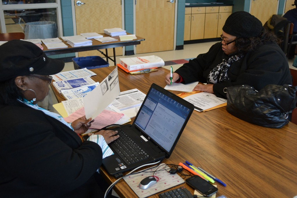 A volunteer tax preparer works with a client at SDC's Teutonia site. (Photo provided by SDC)