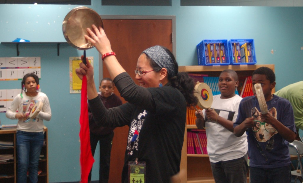 Fourth-grade students at Starms Discovery Learning Center participate in an hour-long Korean drumming class taught by Saehee Chang. (Photo by Morgan Hughes)