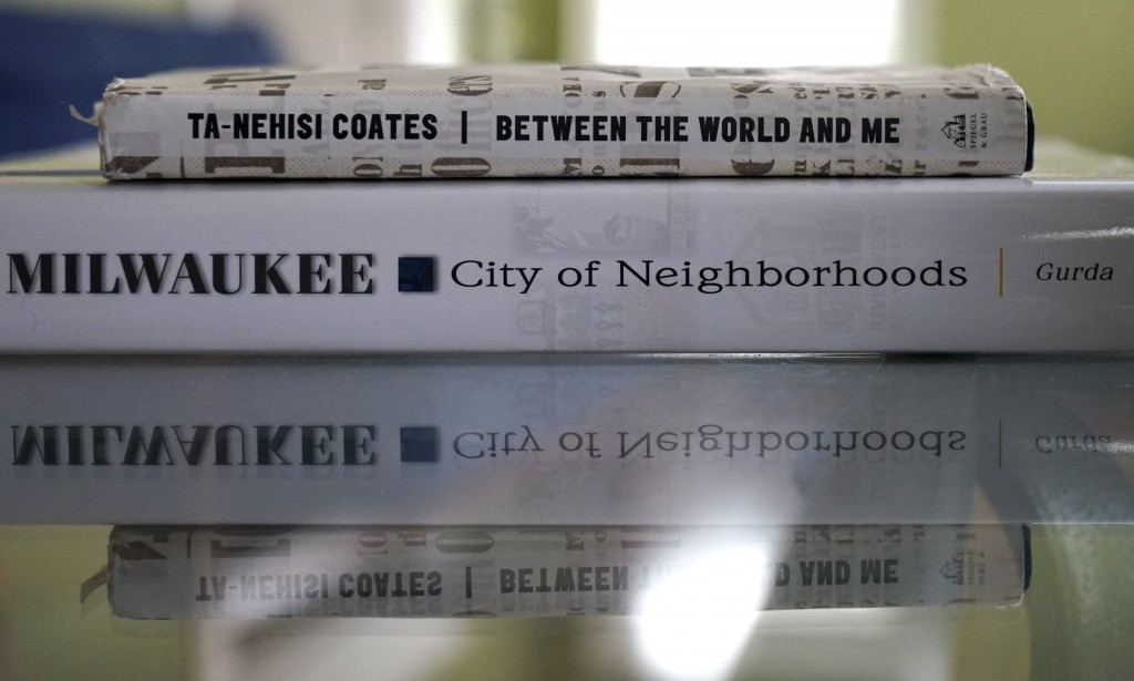 """Between the World and Me"" by Ta-Nehisi Coates and ""Milwaukee: City of Neighborhoods,"" John Gurda's most recent book. (Photo by Adam Carr)"