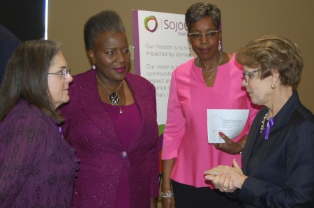 (From left) Carmen Pitre, CEO, Sojourner Family Peace Center; Thelma Sias, vice president for local affairs, WEC Energy Group; Cecelia Gore, executive director, Brewers Community Foundation; and Peggy Troy, CEO, Children's Hospital of Wisconsin chat at the center's grand opening. (Photo by Andrea Waxman)