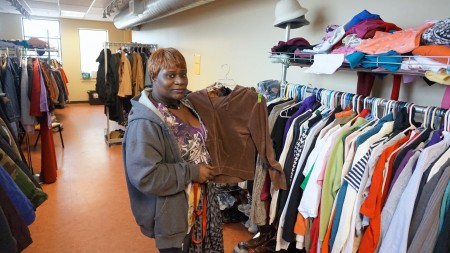 Monica Walter arranges clothing donations at Repairers of the Breach near 14th & Vliet. (Photo by Mark Siegrist)
