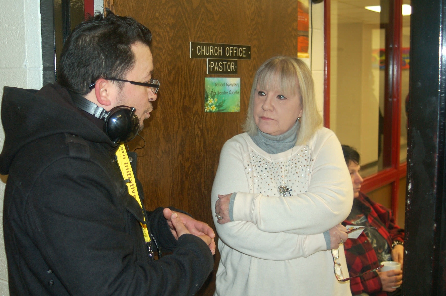 Jose Vasquez speaks to Nora Lenga, secretary at Christ-St. Peter Lutheran School, as part of his outreach to Clarke Square faith-based groups.