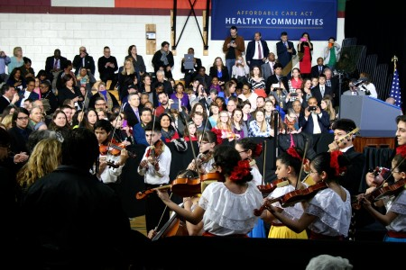 Students from the Latino Arts Strings Program perform before the president's remarks at the United Community Center. (Photo by Jabril Faraj)