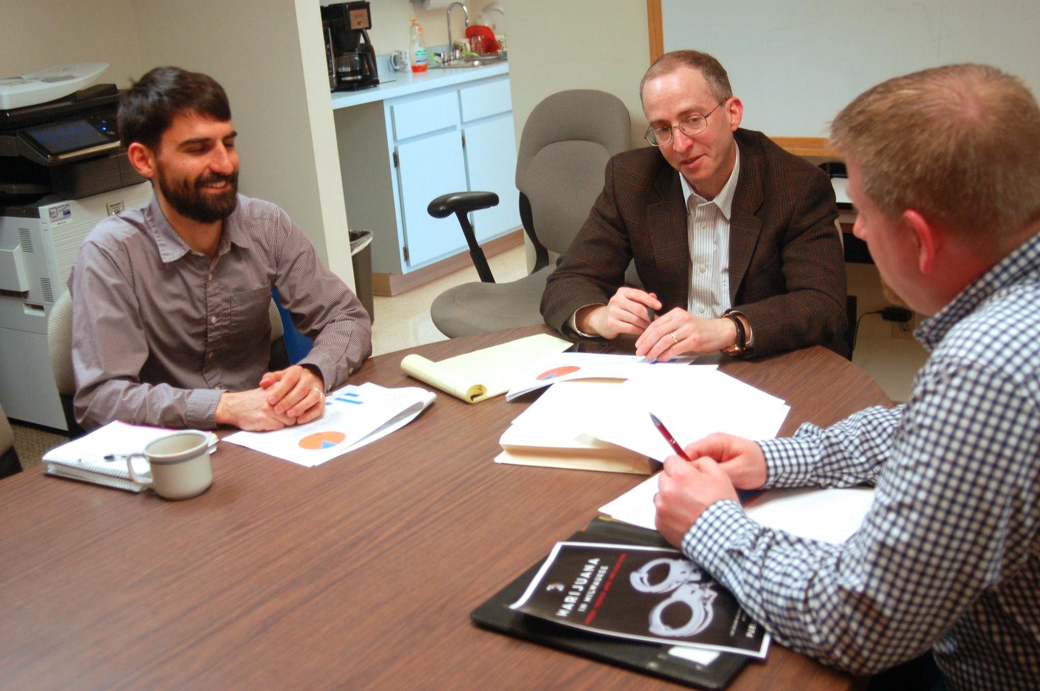 Rob Henken, Public Policy Forum president (center) and researchers Joe Peterangelo (left) and Jeff Schmidt discuss the report. (Photo by Edgar Mendez)