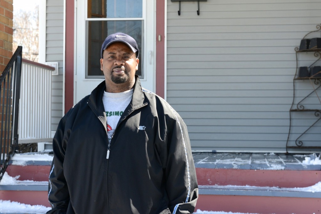 New homeowner Randy Jones stands outside of his Milwaukee Rising home. (Photo by Sue Vliet)