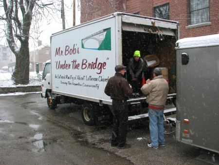 Mr. Bob's Under the Bridge volunteers unload a truck in the parking lot of Redeemer Lutheran Church. (Photo by Brendan O'Brien)