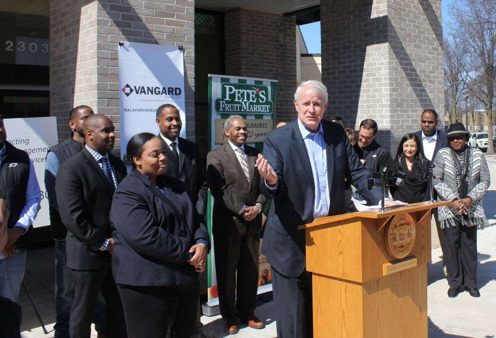 Mayor Tom Barrett and District 6 Ald. Milele Coggs (left) announce that a Pete's Fruit Market is coming to Bronzeville. (Photo by Mark Doremus)