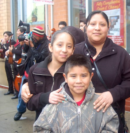 Araceli Gonzalez, her daughter Conrada and son Sal, joined hundred of residents for the unveiling of the Cesar E. Chavez statue at the Supermercado El Rey pedestrian plaza recently. (Photo by Edgar Mendez)