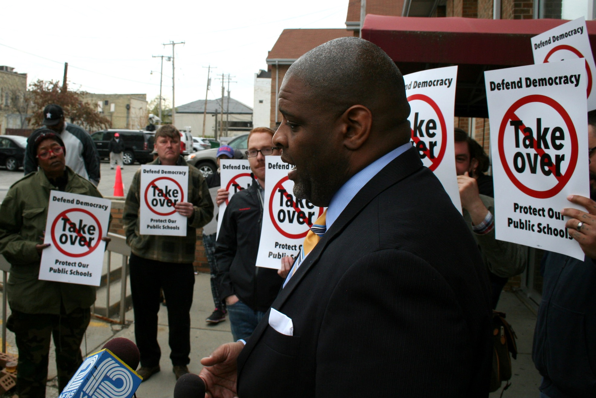Demond Means speaks to reporters before an OSPP advisory committee meeting. (Photo by Jabril Faraj)