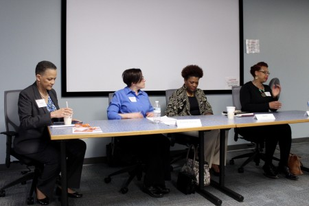 Panelists Paula Penebaker, president and CEO of YWCA of Southeastern Wisconsin; Jeanne Geraci, executive director of the Benedict Center; Dana World-Patterson, chair of the Human Trafficking Task Force of Greater Milwaukee; and Tracy Johnson, assistant U.S. attorney, discuss how human trafficking is related to racism in Milwaukee. (Photo by Morgan Hughes)