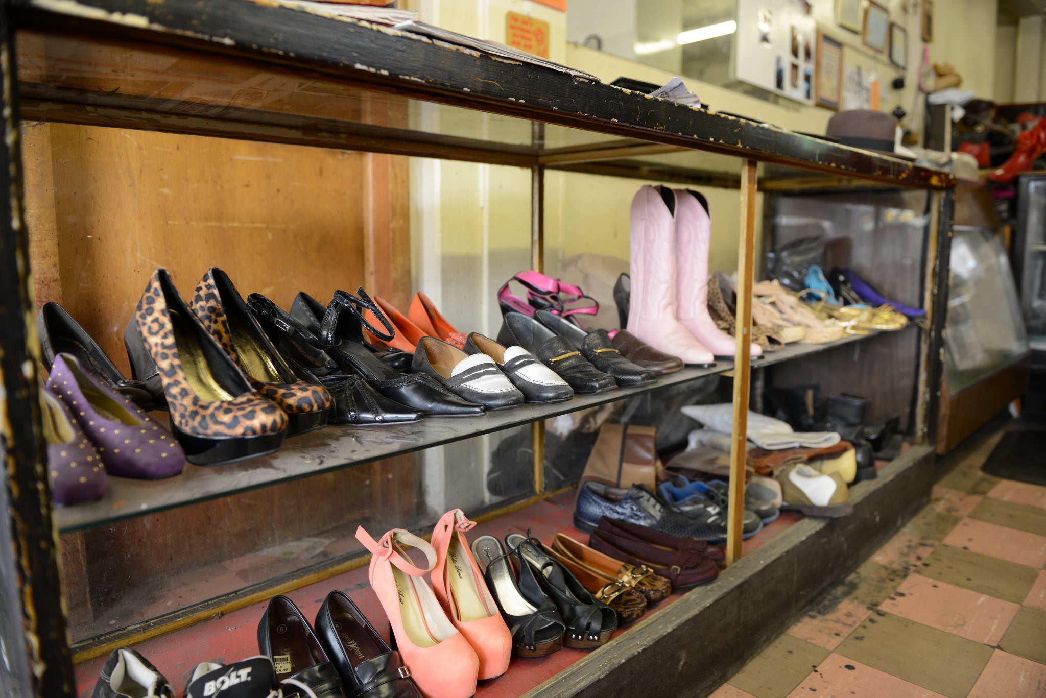 Caption: Owners will pick up their shoes up after they are cleaned and repaired at Scruggs & Sons Shoe Repair. (Photo by Sue Vliet)