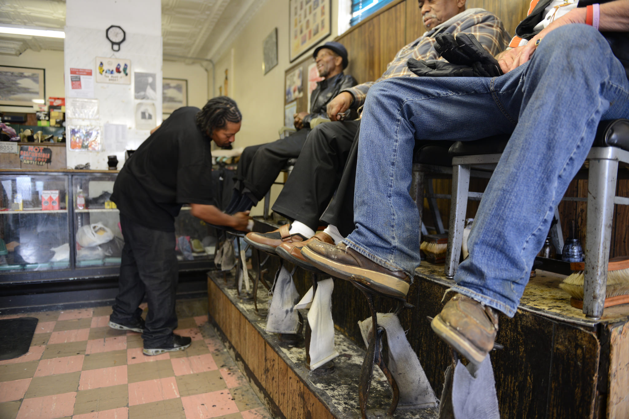 Jerrell Washington shines shoes at Scruggs & Sons Shoe Repair. (Photo by Sue Vliet)