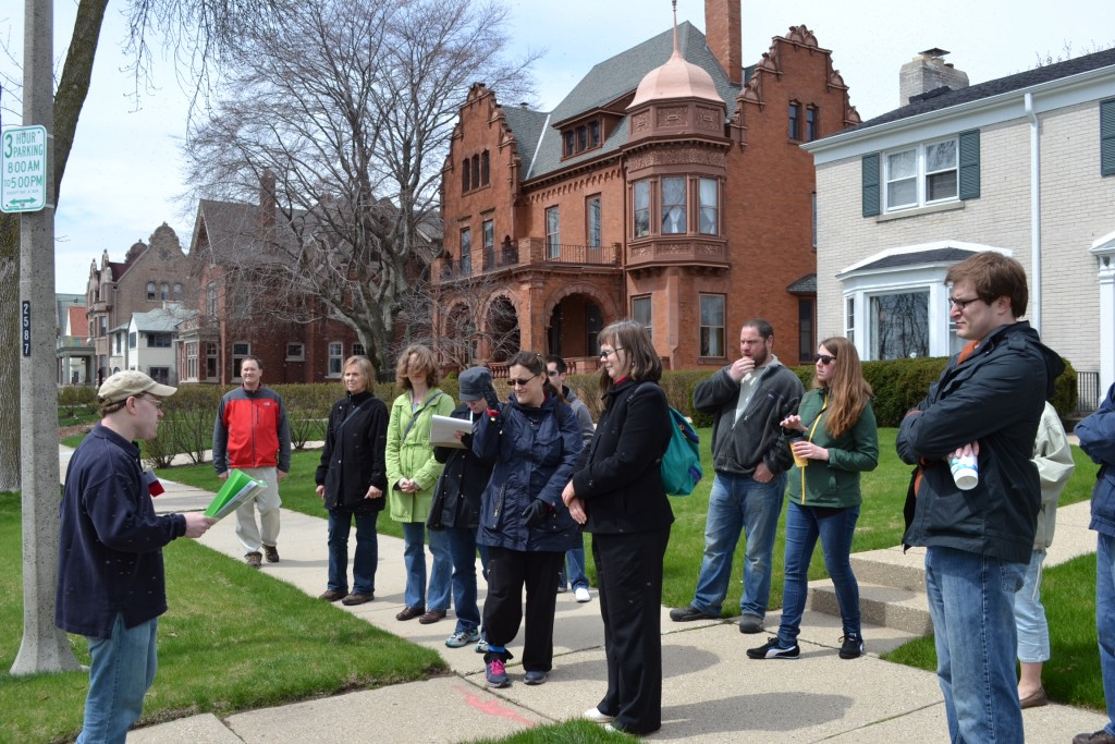 A tour guide leads a recent home tour. (Photo courtesy of Historic Milwaukee)