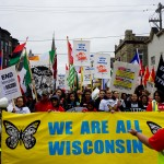 More than 1,000 people march in the 10th annual May Day parade