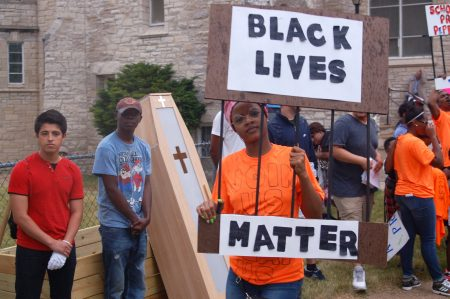 MICAH's 53206 Holy Ground Youth and Young Adult Organizing Project leaders gather outside Incarnation Lutheran Church before addressing elected officials. (Photo by Andrea Waxman)