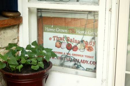 That Salsa Lady sign graces the front window of That Hood Ranch. (Photo by Amelia Jones)