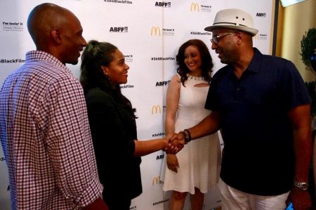 Wardlaw shakes hands with director Malcolm Lee at the Ritz-Carlton Hotel in Miami Beach during the 20th Annual American Black Film Festival last month, as the other finalists look on. (Photo courtesy of the American Black Film Festival)