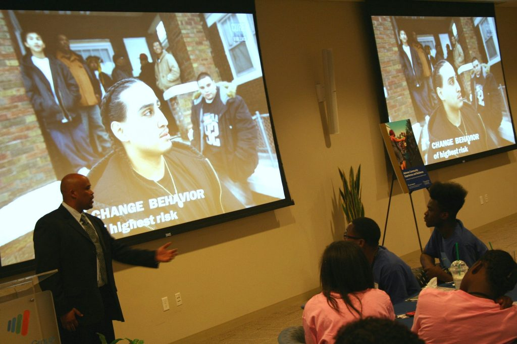 Marcus McAllister addresses a group of young people at an Office of Violence Prevention lunch. (Photo by Jabril Faraj)