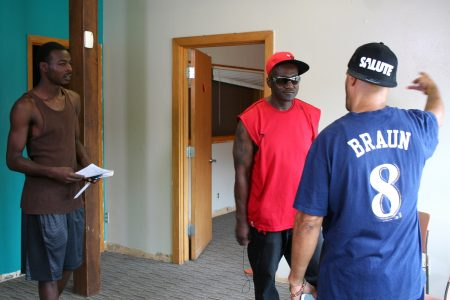 Safe Zones Ambassador Broderick Thompson (left) role-plays active listening during a tense situation at an ambassadors' training. (Photo by Jabril Faraj)
