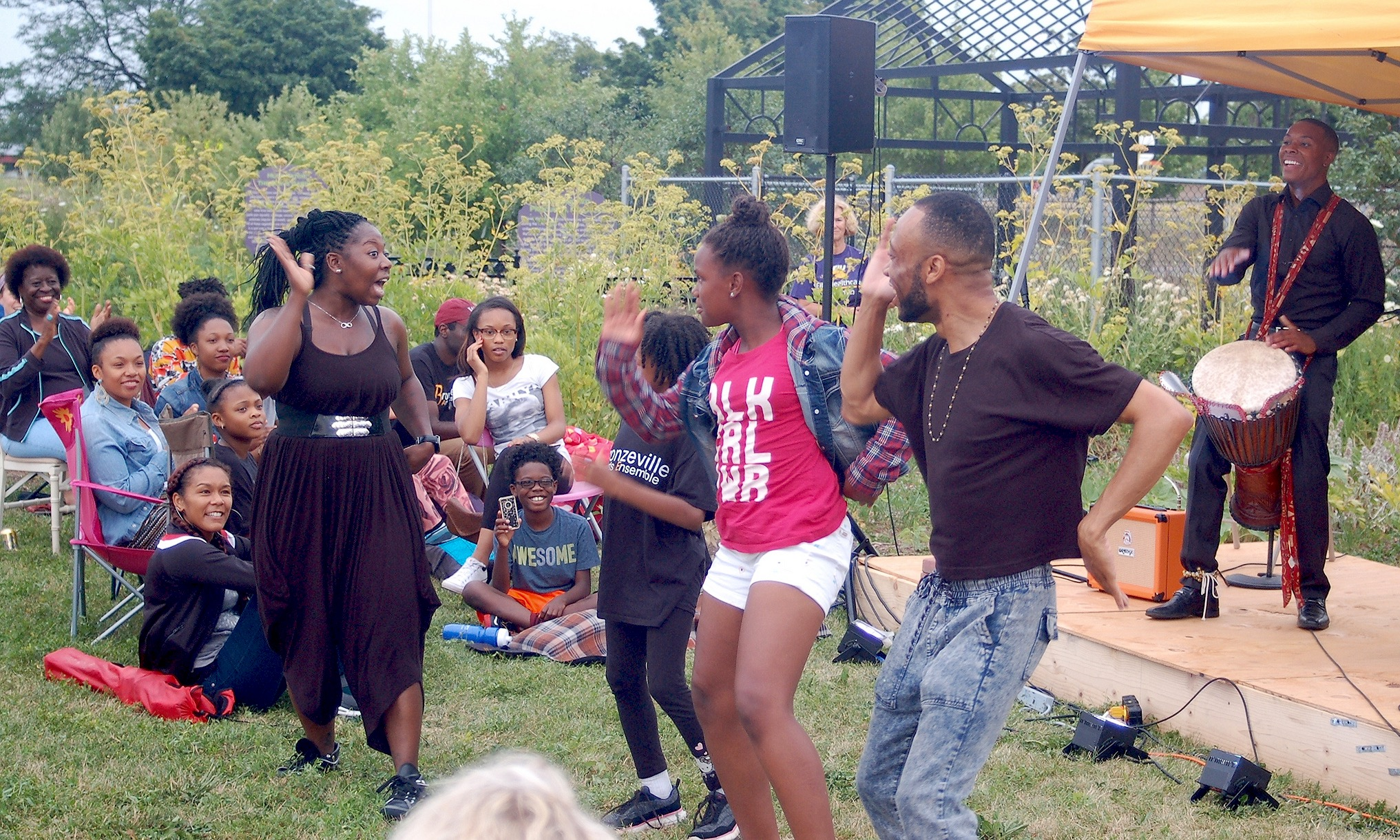 Members of the Ko-Thi Dance Company invite audience members to participate in their performance at Alice's Garden. (Photo by Andrea Waxman)