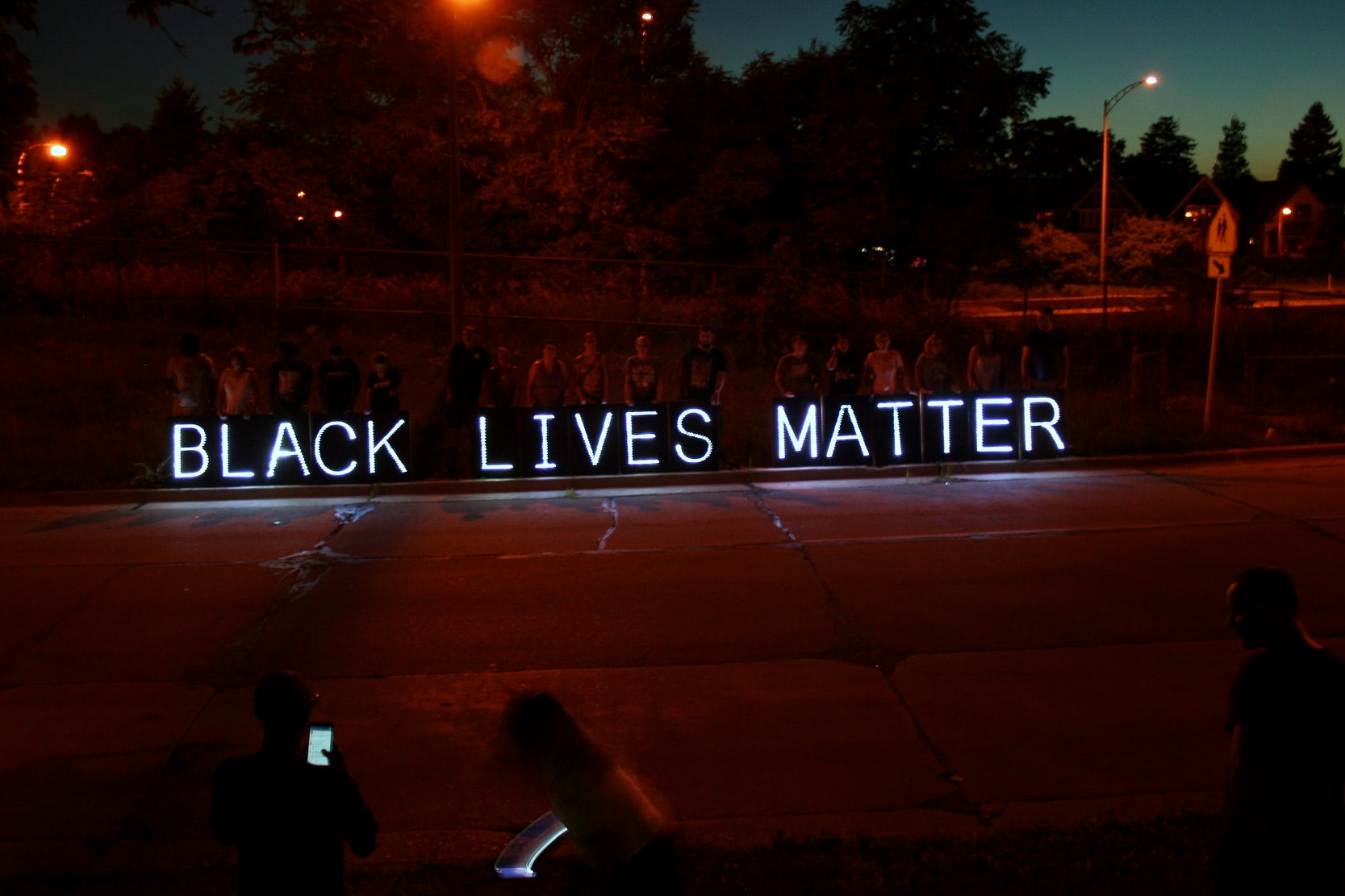 """Black Lives Matter"" was visible in illuminated letters from I-43 northbound. (Photo by Jabril Faraj)"