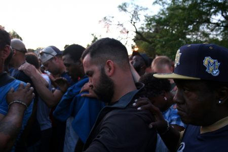 A diverse group of Milwaukee residents gathered near Sherman Park to pray for healing. (Photo by Jabril Faraj)