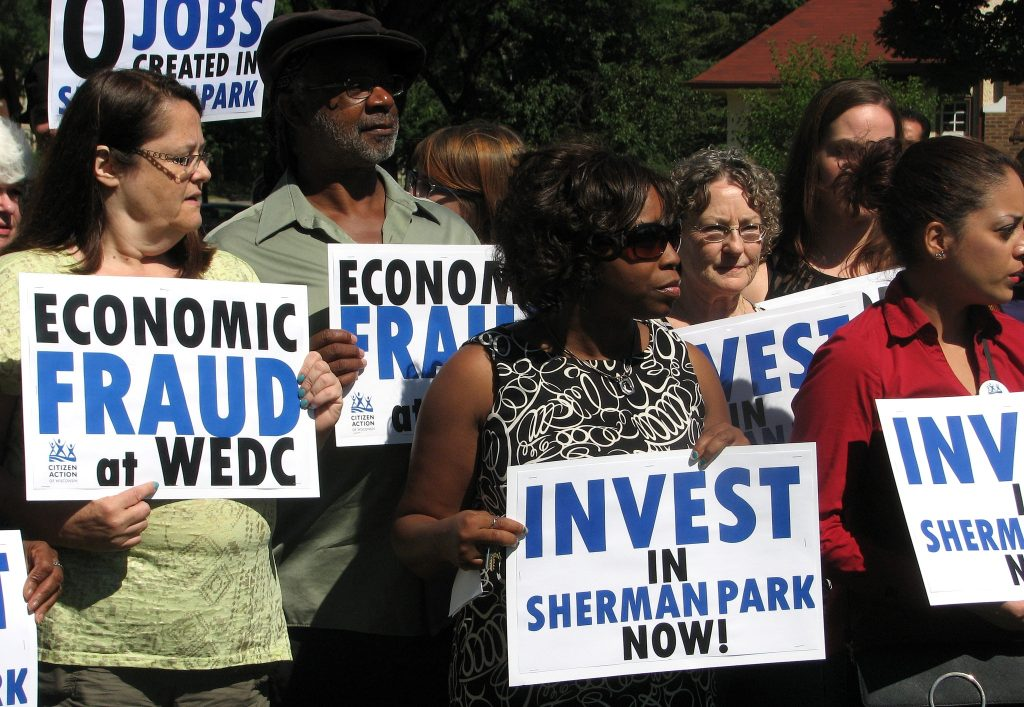 Sherman Park residents call out the Wisconsin Economic Development Corporation for inaccurately reporting the number of jobs it has created in their neighborhood.  (Photo by Brendan O'Brien)