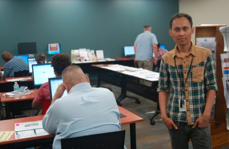 Maung Pa Aye, a displaced Cargill worker, now works as a resource room specialist for Employ Milwaukee. (Photo by Edgar Mendez)