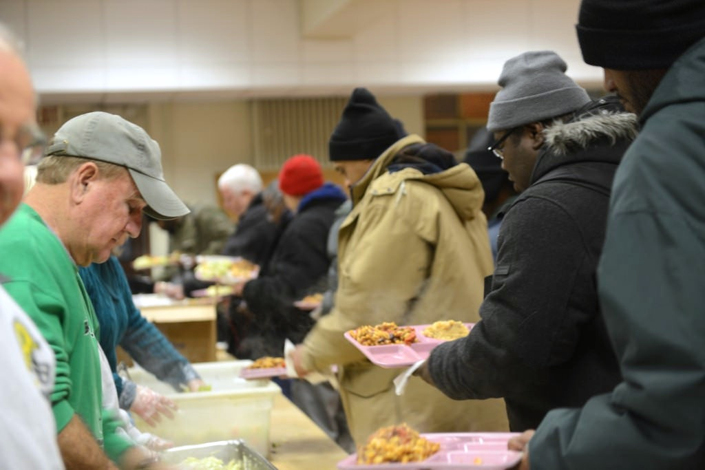 St. Ben's Community Meal, a program of St. Benedict the Moor parish, provides dinner to impoverished Milwaukeeans six days a week. (Photo by Sue Vliet)