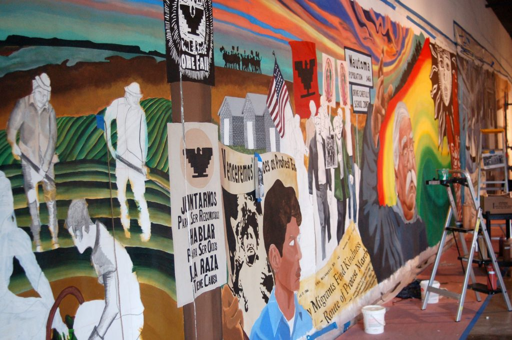 A 9- by 90-foot mural honoring the 50-year legacy of UMOS will eventually be set on a building on South 1st Street and West Mitchell. (Photo by Edgar Mendez)