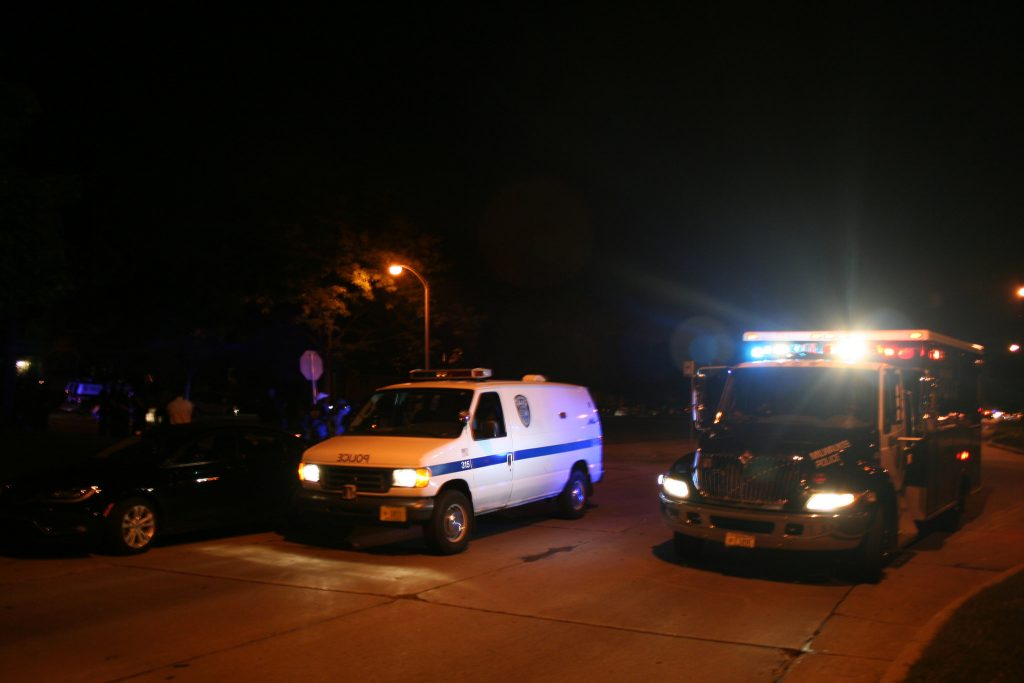 More than 40 officers and six police vehicles filled the intersection of Sherman Boulevard and W. Auer Avenue after 9:30 p.m. Tuesday night. (Photo by Jabril Faraj)