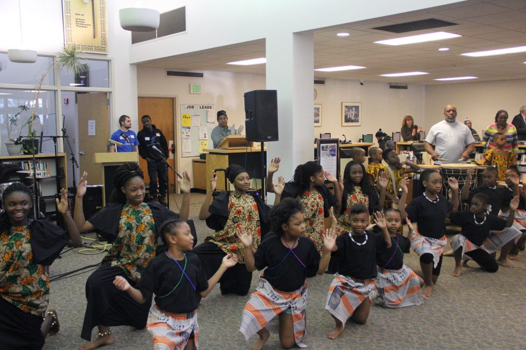 A large crowd watched members of the Nefertari African Dance Company perform a routine at the MLK Library on MLK Day in 2016. (Photo by Morgan Hughes)